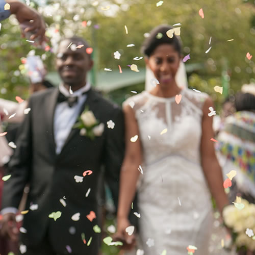 Bride and groom showered in confetti